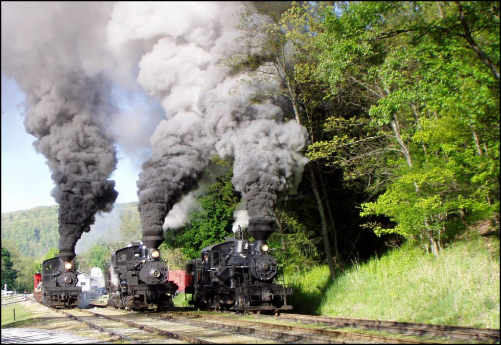 photograph of 3 American trains